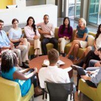 Work team sitting in circle