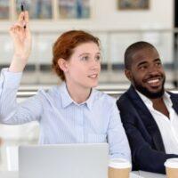 Woman raising her hand while training