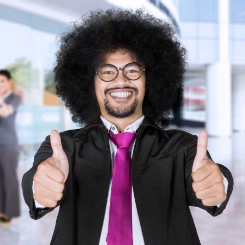 Man giving thumbs up and smiling