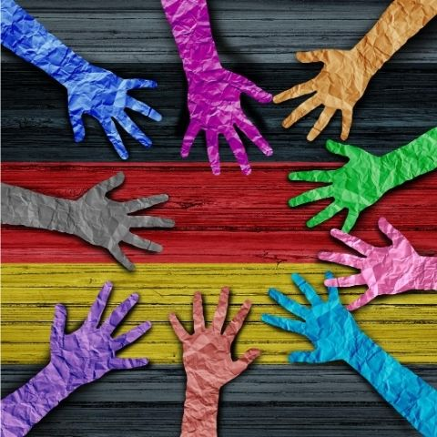 Rainbow colored hands making circle