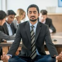 Man doing yoga in office